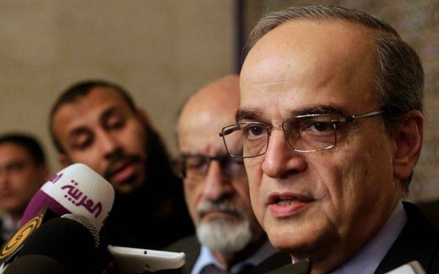 Hadi Bahra, a senior member of the Syrian National Coalition, speaks during a press conference following his meeting with the Arab League's Secretary-General Nabil Elaraby in Cairo, Egypt, on December 27, 2014. (AP/Amr Nabil, File)