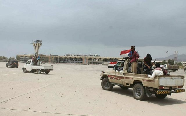 Fighters against Shiite rebels known as Houthis gather in front of the airport in the port city of Aden, Yemen,  July 16, 2015. (AP/Abo Muhammed)