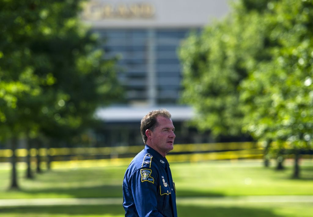 Col. Mike Edmondson, superintendent of the Louisiana State Police, walks in front of the Grand Theatre in Lafayette, La., Friday, July 24, 2015. A gunman opened fire on moviegoers inside the theater Thursday. (Paul Kieu/The Daily Advertiser via AP)