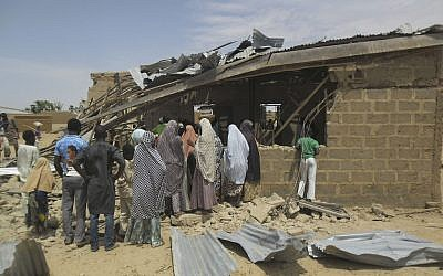 People gather at the site of a suicide bomb attack at Redeem Christian Church in Potiskum, Nigeria, which has been blamed on Boko Haram, July 5, 2015. (Adamu Adamu/AP Photo)