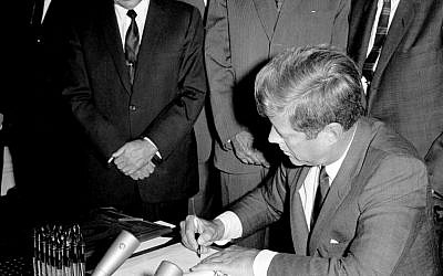 In this Oct. 7, 1963, file photo, President John F. Kennedy signs the Limited Test Ban Treaty during a ratification ceremony in the White House Treaty Room in Washington (AP Photo/File)