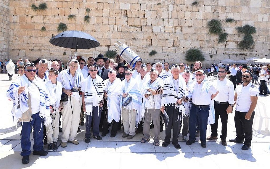 Holocaust survivors celebrate their bar mitzvah at the Western Wall, in Jerusalem, on Monday, July 13 2015. (Oren Hassidim)