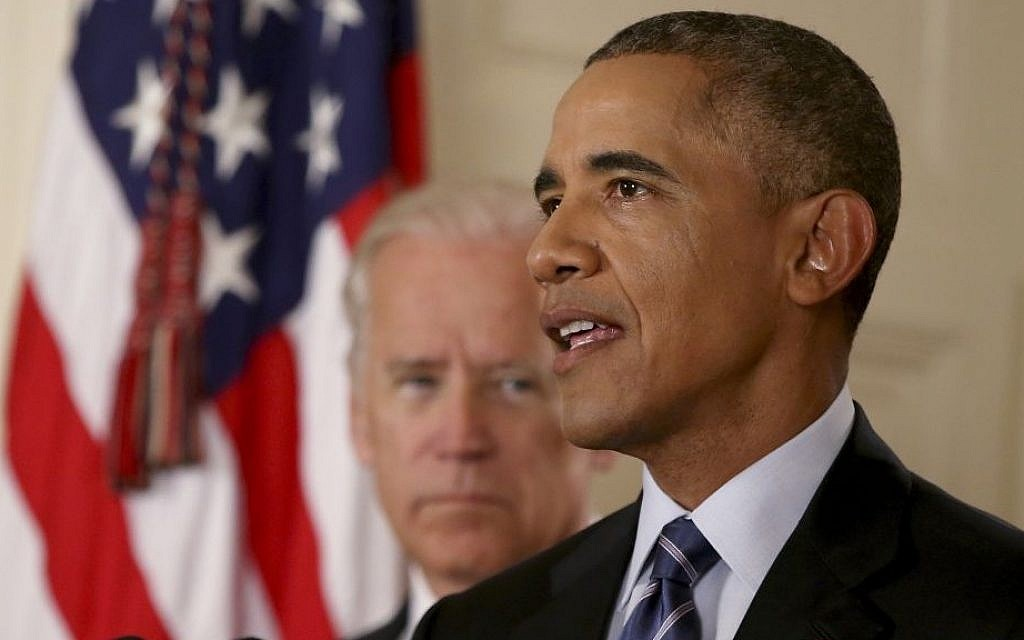 US President Barack Obama delivers remarks in the East Room of the White House as Vice President Joe Biden looks on, July 14, 2015 in Washington, DC. (AFP Photo/Pool/Andrew Harnik)