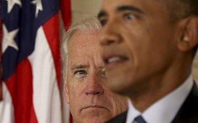 US Vice President Joe Biden listens as President Barack Obama delivers remarks in the East Room of the White House in Washington, July 14, 2015, after an Iran nuclear deal is reached. (AP Photo/Andrew Harnik, Pool)