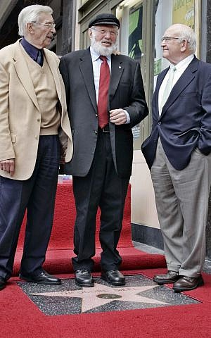 In this 2005 file photo, Theodore Bikel, center, with fellow actors Martin Landau, left, and Ed Asner, pose for photos during a dedication ceremony for Bikel's star on the Hollywood Walk of Fame in Los Angeles. (Reed Saxon/AP Photo, File)