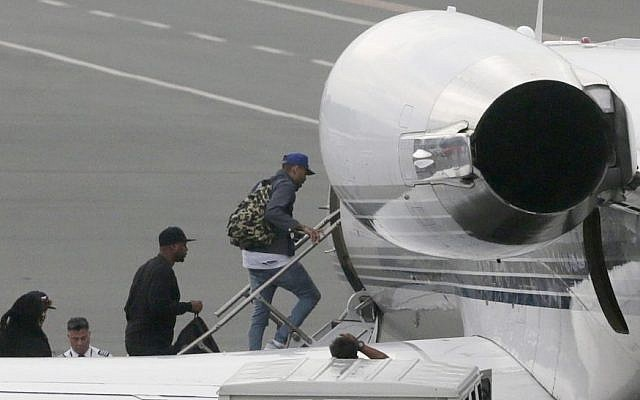 Grammy award-winning singer Chris Brown boards a chartered jet at the old Manila Domestic Airport in suburban Pasay city, south of Manila, Philippines, Friday, July 24, 2015. (AP/Bullit Marquez)