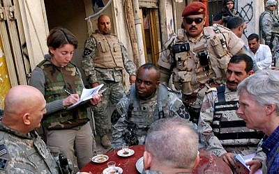 Emma Sky (second left) tours Doura Market in Baghdad in April, 2007 (Courtesy Curt Cashour)