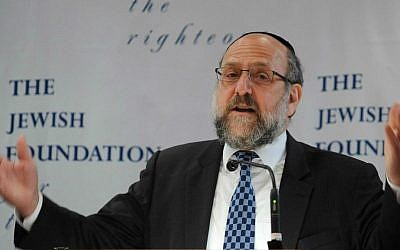 Chief Rabbi of Poland Michael Schudrich speaks during an event gathering nearly 50 elderly Christian Poles who saved Jews during World War II, in Warsaw, Poland, Sunday, July 12, 2015. (AP Photo/Alik Keplicz)