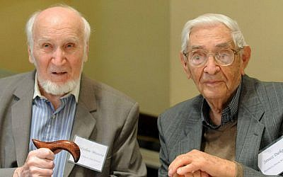 File: Rescuers Janusz Durko, 100 years old, right, and Wladyslaw Misiuna, 90 years old, attend an event gathering nearly 50 elderly Christian Poles who saved Jews during World War II, in Warsaw, Poland, Sunday, July 12, 2015. (AP Photo/Alik Keplicz)