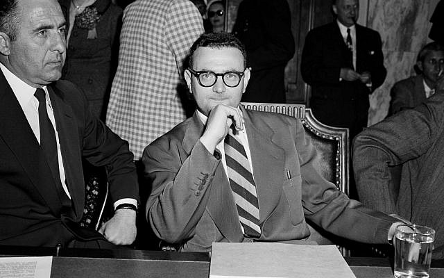 In this April 26, 1956 file photo, David Greenglass, convicted atomic spy, sits beside Deputy U.S. Marshal Joseph Oreto during a Senate Internal Security on Capitol Hill in Washington (AP Photo/Henry Griffin)