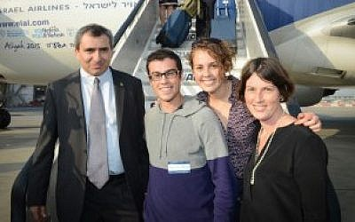 Yaniv and Hilla Singerman are flanked by Israel's minister of aliyah and immigration absorption, Zeev Elkin, left, and their sister, Rachel Gur, an adviser to Elkin, at Ben Gurion Airport near Tel Aviv, July 14, 2015. (Courtesy of Shahar Azran/Nefesh B'Nefesh/JTA)