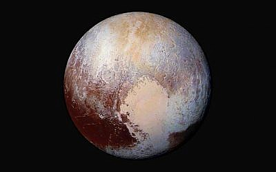 This image made available by NASA on Friday, July 24, 2015 shows a combination of images captured by the New Horizons spacecraft with enhanced colors to show differences in the composition and texture of Pluto's surface. The images were taken when the spacecraft was 280,000 miles (450,000 kilometers) away. (NASA/JHUAPL/SwRI via AP)
