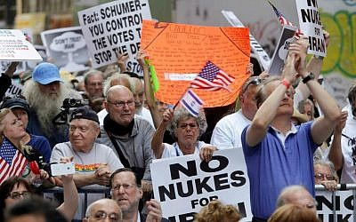 Supporters react to a speech by Republican presidential candidate former New York Gov. George Pataki at the 'Stop Iran' protest Wednesday, July 22, 2015, near Times Square in New York. (AP Photo/Frank Franklin II)