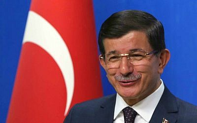 Turkish Prime Minister and leader of Justice and Development Party Ahmet Davutoglu speaks to the media after a meeting with Kemal Kilicdaroglu, the leader of the main opposition Republican People's Party, CHP, in Ankara, Turkey, Monday, July 13. 2015. (AP Photo/Burhan Ozbilici)