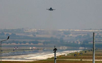 A Turkish Air Force warplane takes off from the Incirlik Air Base, on the outskirts of the city of Adana, southeastern Turkey, Tuesday, July 28, 2015. (AP Photo/Emrah Gurel)