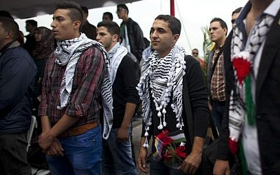 In this Nov. 6, 2014 file photo, Palestinian students attend a welcome ceremony at the Simon Bolivar airport in Maiquetia, Venezuela. The Palestinian students were greeted like celebrities upon arrival in Caracas. President Nicolas Maduro played up their symbolic importance during an address broadcast across the country. (AP Photo/Ariana Cubillos, File)
