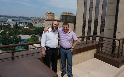 Zelig Brez, left, the director of the Jewish Community of Dneproptrovsk, with a local donor, Natan Zolotarevsky, on the roof of the Menorah Center in the eastern Ukraine city, July 15, 2014. (Cnaan Liphshiz/JTA)