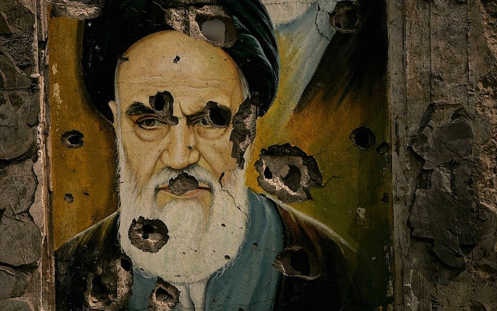A bullet ridden picture of Ayatollah Ruhollah Khomeini, the late founder of Iran's Islamic Republic, is displayed in Bent Jbail, Lebanon.  (Photo by Spencer Platt/Getty Images, via JTA)