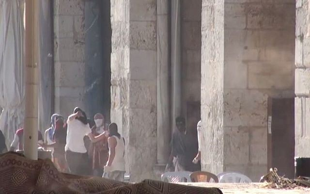 Palestinian rioters hurl rocks at Israeli Police in front of the al-Aqsa Mosque on the Temple Mount in Jerusalem on Sunday, July 26, 2015. (screen capture: Israel Police video)
