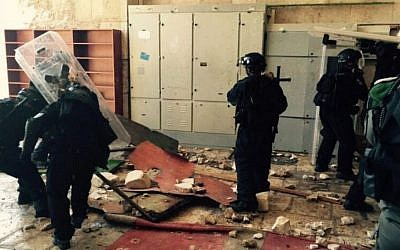 Police at the entrance to Al-Aqsa Mosque on July 26, 2015 after security forces clashed with dozens of masked protesters. (Jerusalem police)