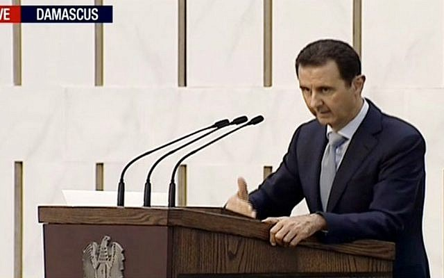 Syrian President Bashar Assad delivering a speech in Damascus, Syria on Sunday, July 26, 2015. (Press TV via AP video)
