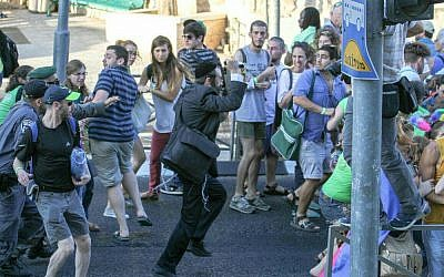 Participants in the gay pride parade in Jerusalem flee stabber Yishai Schlissel, July 30, 2015. (Photo: Koby Shotz)