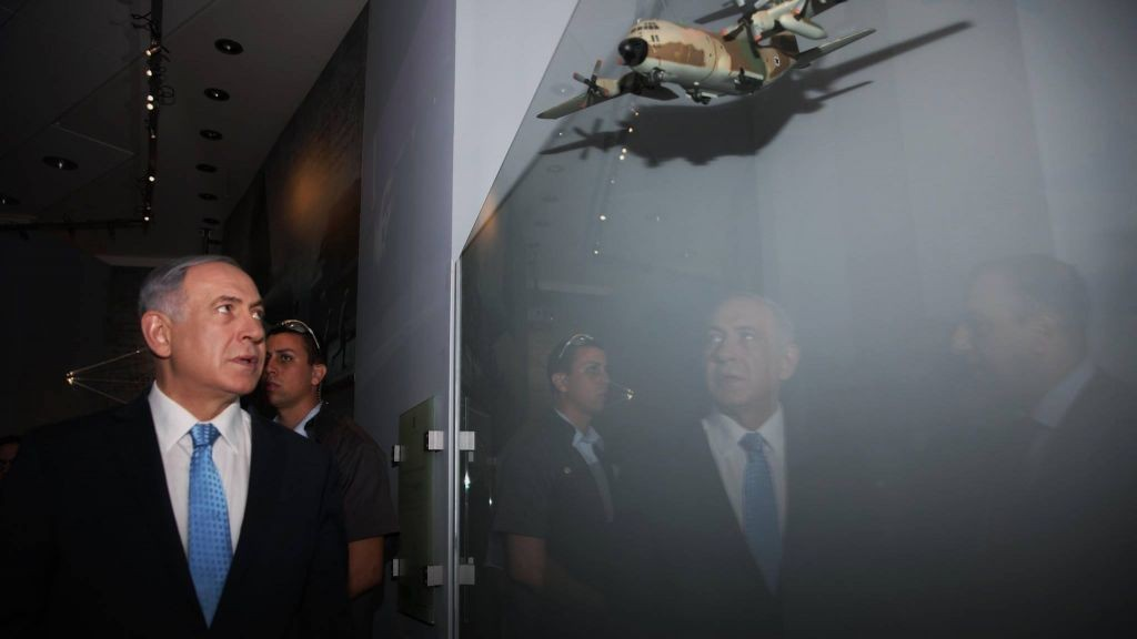 Prime Minister Benjamin Netanyahu tours the new Entebbe exhibition at the Rabin Center on July 9, 2015. His brother Yoni was killed in the 1976 hostage rescue mission. (via Facebook)