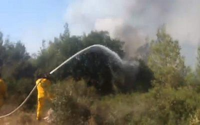 Firefighters battle a massive wildfire in the Beit Shemesh area, July 24, 2015. (screen capture)