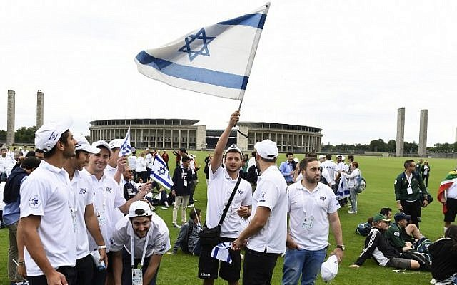 """Members of the Israel's Maccabi team team at  Berlin's so-called """"Maifeld,"""" where the Nazis once held mass rallies, on July 28, 2015. (AFP PHOTO / TOBIAS SCHWARZ)"""