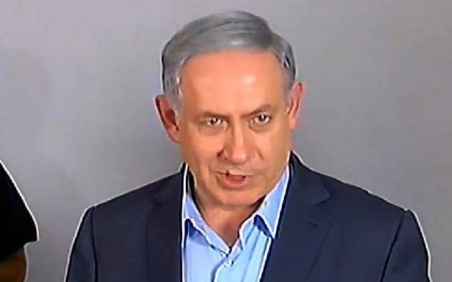 Prime Minister Benjamin Netanyahu speaks to reporters on July 10, 2015 outside the family home of Avraham Mensigu, an Israeli captive held in Gaza. (Screen capture/Channel 2)