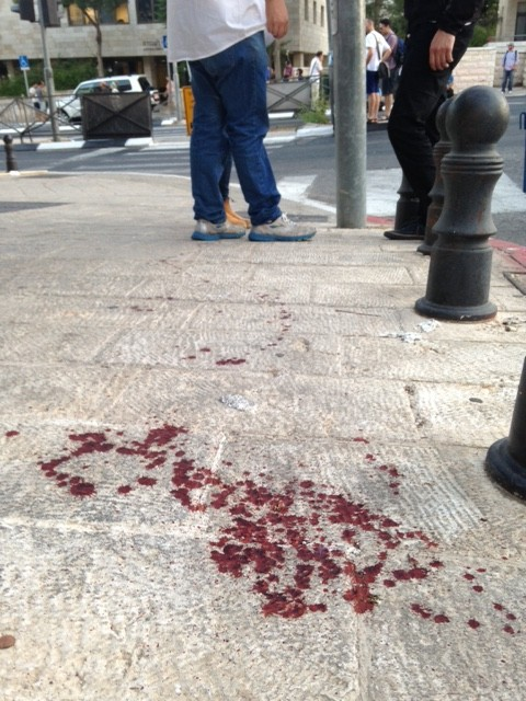 Bloodstained sidewalk at the scene of a stabbing at the annual Jerusalem Pride Parade on July 30, 2014. (Stuart Winer/Times of Israel)