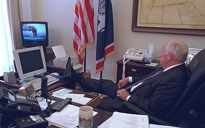 Then-vice president Dick Cheney watches a TV broadcast of the Twin Towers burning following the attack on New York on September 11, 2001. (US National Archives)