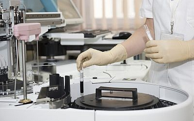 A clinician works on a new medical formulation at a lab (Pexels)