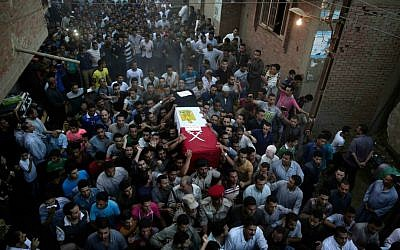 Egyptians carry the coffin of 1st Lt. Mohammed Adel Abdel Azeem -- killed on July 1, 2015, in an attack by Islamic extremists in the Sinai -- during the funeral procession in his home village of Tant al-Jazeera, north of Cairo, Egypt, July 2, 2015. (Hassan Ammar)