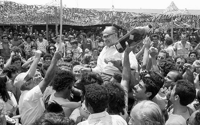 An Israeli crowd celebrating the successful mission, with what looks like future prime minister Menachem Begin (Courtesy IDF Archive)