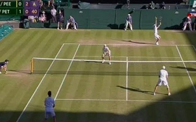 Yoni Erlich, at the net on the far side of the court, during the Wimbledon men's doubles semi-final on July 9, 2015 (Channel 5 screenshot)