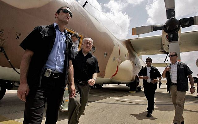 Prime Minister Benjamin Netanyahu walks out of a C-130 Hercules aircraft, used in the raid to release Israeli hostages held at Entebbe airport in Uganda in 1976, during a visit to Hatzerim Air base near Beersheba in 2009. (Photo by Edi Israel/Flash90)