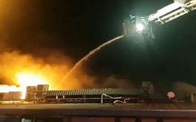 A fire burns at the Tel Aviv port restaurant Mul Hayam (screen capture: Ynet)