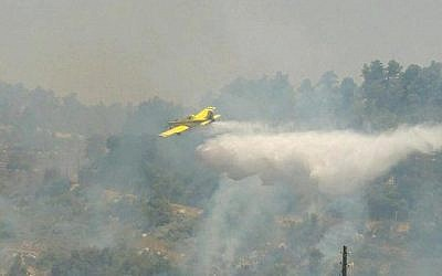 A firefighting aircraft operates near Kibbutz Ma'ale Hahamisha outside Jerusalem, July 4, 2015, to put out a fire that authorities suspect was arson. (Israel Fire and Rescue Services)