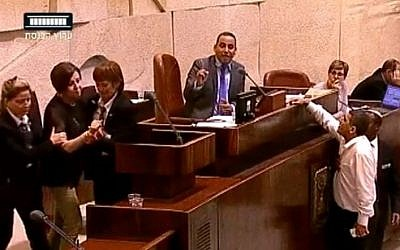 Meretz chairwoman Zehava Gal-on is removed from the Knesset plenum for insulting an MK on July 13, 2015. (screen grab: YouTube)
