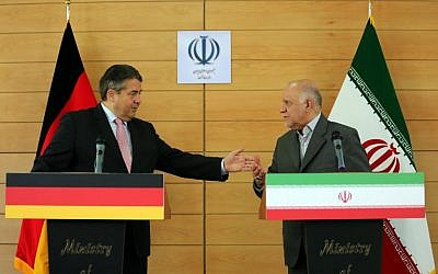 German Economy and Energy Minister Sigmar Gabriel (L) speaks alongside Iranian Oil Minister Bijan Namdar Zanganeh during a press conference in Tehran on July 20, 2015. (Atta Kenare/AFP)