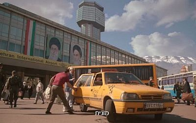 Gidi Gov gets into a cab at the fake Tehran airport in Kiev, in Bezeq's 'smart home' ad (Bezeq screenshot)