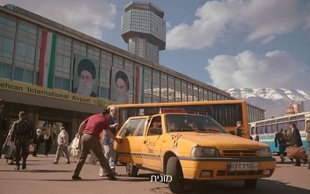 Gidi Gov gets into a cab at the fake Tehran airport in Kiev, in Bezeq's 'smart home' ad (Bezeq screenshot)