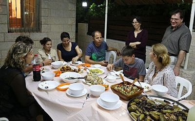 Three Jewish families and one Muslim family gather for an iftar toward the end of Ramadan (Eric Cortellessa/Times of Israel)