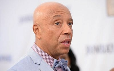 Russell Simmons attends the RUSH Philanthropic Arts Foundation's Art for Life Benefit at Fairview Farms in Water Mill on Saturday, July 18, 2015, in New York. (Scott Roth/Invision/AP)