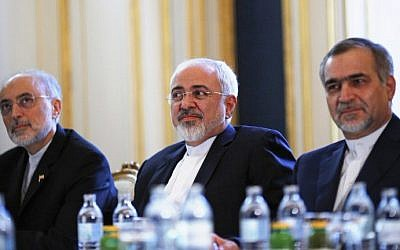 Iranian Foreign Minister Mohammad Javad Zarif (C), the Head of the Iranian Atomic Energy Organization Ali Akbar Salehi (L) and Hossein Fereydoon (R), brother and close aide to President Hassan Rouhani, are pictured during a meeting with the US Secretary of State in Vienna on July 3, 2015 (AFP/POOL/CARLOS BARRIA)