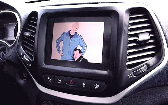 As part of their hack, Charlie Miller and Chris Valasek broadcast their cartoon images on the entertainment center display of a Jeep Cherokee driven by Wired's Andy Greeberg (Youtube screenshot)