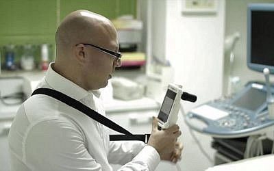 A doctor uses a  MobileODT colposcope (Photo credit: Courtesy)