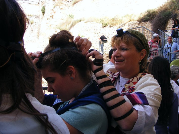 Nathalie Lastreger participating in prayer at Jerusalem's Western Wall. (courtesy)