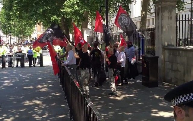 Two dozen neo-Nazis demonstrate in London on July 4, 2015 against the 'Jewification' of Golders Green. They were outnumbered by some 200 counter-demonstrators. (Screen capture/TheBlaze/YouTube)